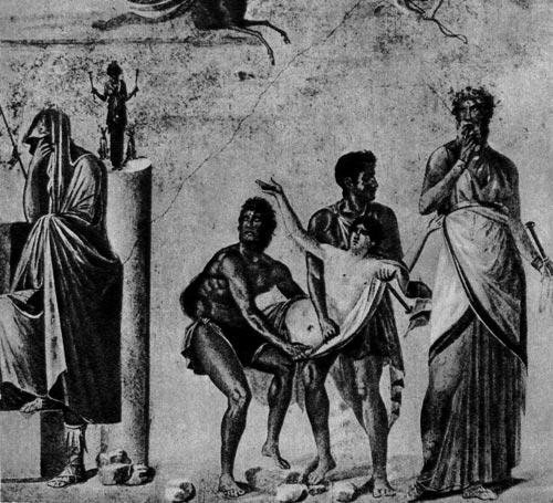 Жертвоприношение Ифигении. Настенная живопись из Помпеи, около 65 г. н. э. Национальный музей, Неаполь. У Агамемнона (слева) вся голова закрыта тогой, на ногах у него- высоко зашнурованные сандалии (калцеи). На мужчинах, несущих Ифигению, короткие плащи и хламиды; жрец (справа) одет 8 тунику и плащ
